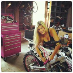 @cynthia341 @pinksprocketracing  Loves working on her toys and pink tools won't get lost in this shop  We love how she created a team to support women in their extreme sports